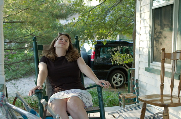 Rachel relaxes on the porch