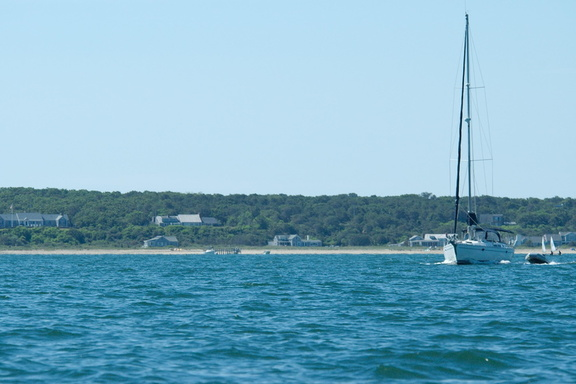 Sailboat under power coming out of Edgartown harbor