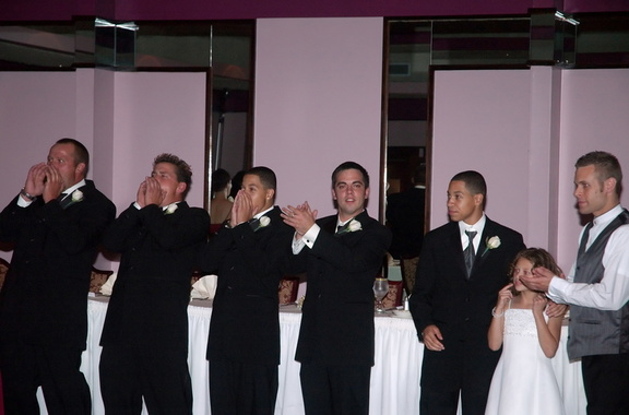 groomsmen applaud the bride and groom